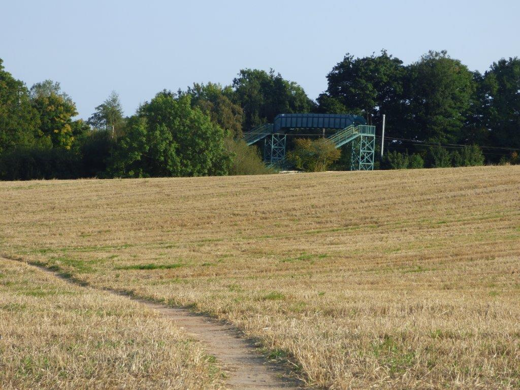 The well-worn path made possible by the new footbridge over the railway line at Cofton Hall.