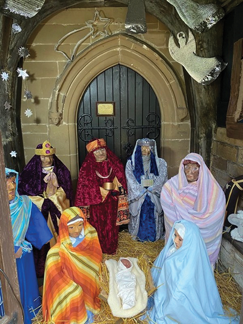 The life-sized Nativity scene in the porch of St Michaels Church, Cofton Hackett, in December 2020.